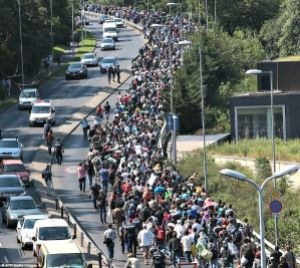 refugees_walk_beside_motorway